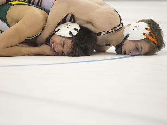 Greeley Central wrestler Josh Nira, right, is one of 21 selected to the Coloradoan's All-Area wrestling team.