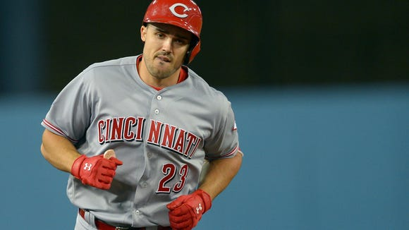 Cincinnati Reds left fielder Adam Duvall (23) rounds the bases after a home run in the fourth inning of the game against the Los Angeles Dodgers at Dodger Stadium.