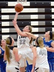 South Lyon East's Abby Jones (23) goes up for the shot
