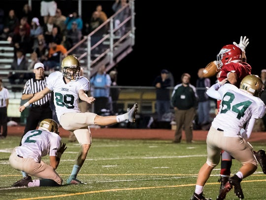 York Catholic's Thomas McGraw (89) kicks an extra point during play against Bermudian Springs on Friday, Oct. 20, 2017. McGraw drilled two field goals (32, 28) and was five for five on PAT's.