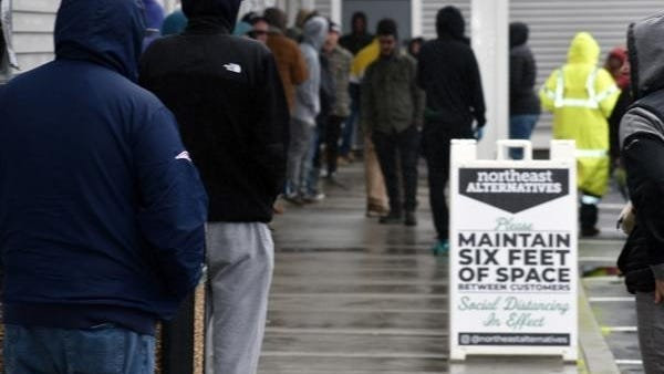 Long lines observe social distancing guidelines outside Northeast Alternatives shop in Fall River. The company is expanding with another retail pot shop in Swansea.