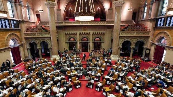 Members of the Assembly debate budget bills at the Capitol on Monday in Albany,