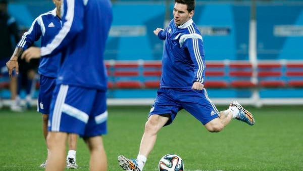 Argentina's Lionel Messi kicks the ball during a training session one day before their World Cup semifinal soccer match between Netherlands and Argentina at Itaquerao Stadium in Sao Paulo, Brazil, Tuesday, July 8, 2014. (AP Photo/Victor R. Caivano)