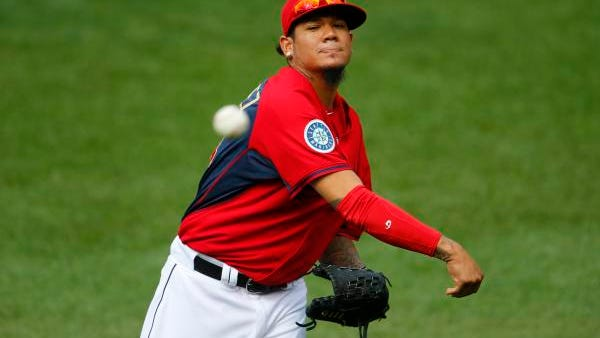 American League starting pitcher Felix Hernandez of the Seattle Mariners throws in the outfield Monday in Minneapolis.