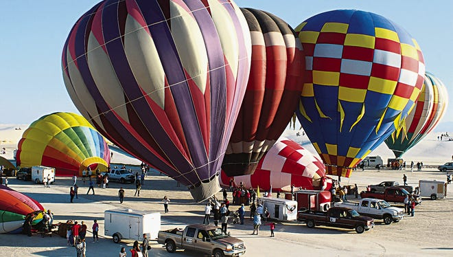 In this 2013 file photo, a group of hot air balloons prepare for launch during the 19th annual White Sands Balloon Invitational on Saturday, Sept. 18, 2013, at White Sands National Monument.