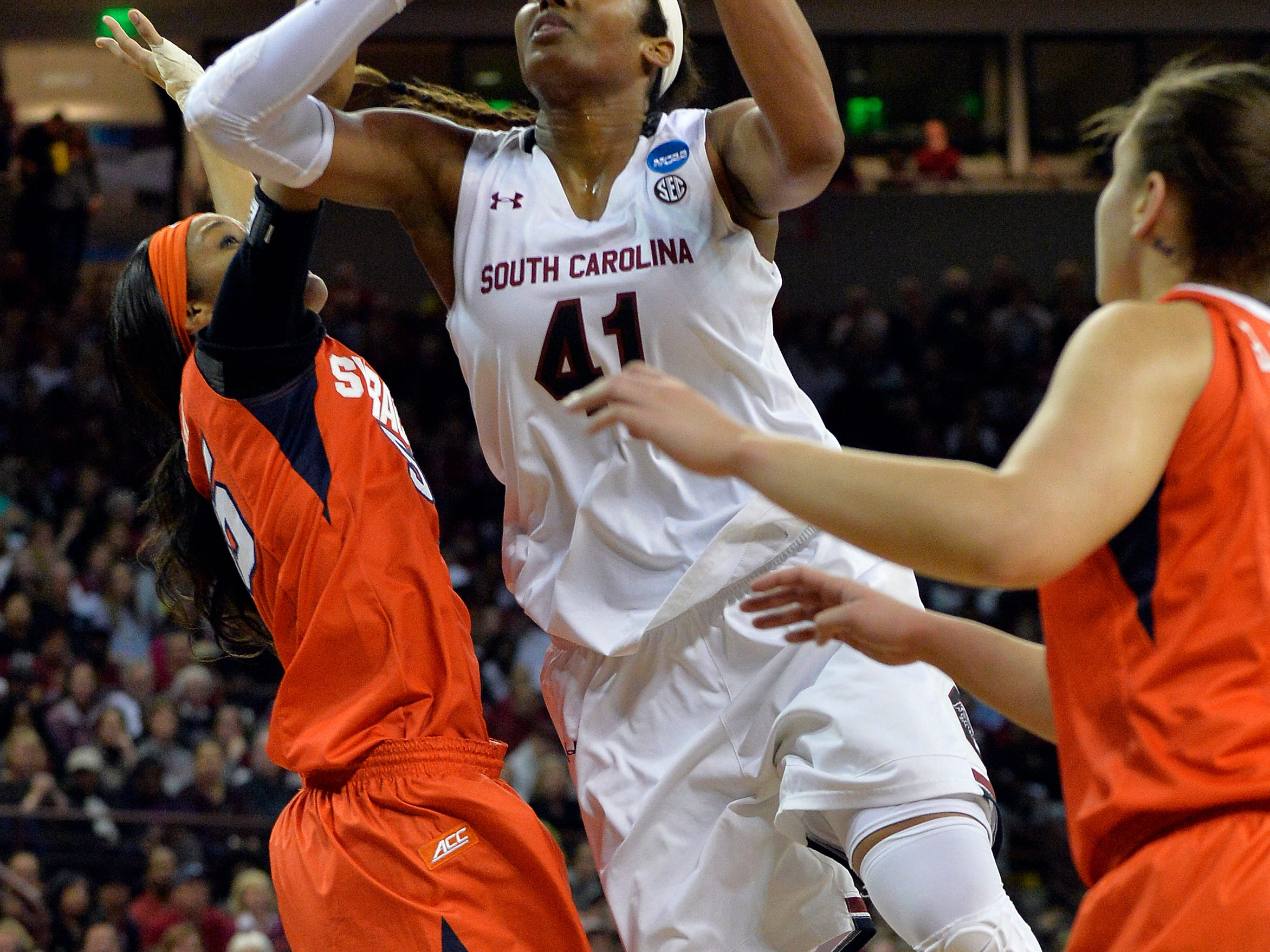 USC center Alaina Coates (41) gets her own rebound and goes back up for the points against Syracuse at Colonial Life Arena in Columbia in the 2nd round of the 2015 NCAA Tournament on Sunday.