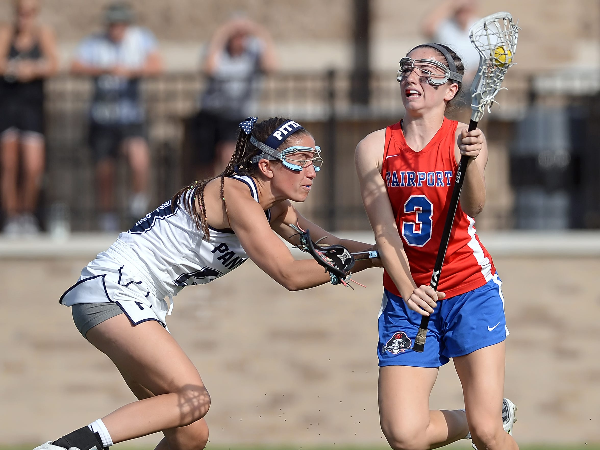 Fairport's Maddie Howe, right, is defended by Pittsford's