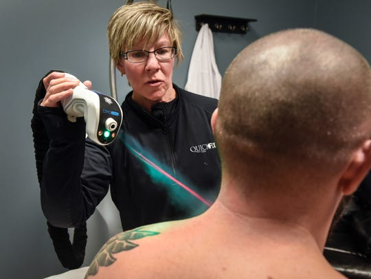 Denise Molesky uses localized cryotherapy on the shoulder