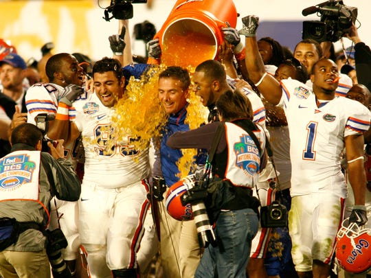 Urban Meyer is doused after Florida beat Oklahoma in
