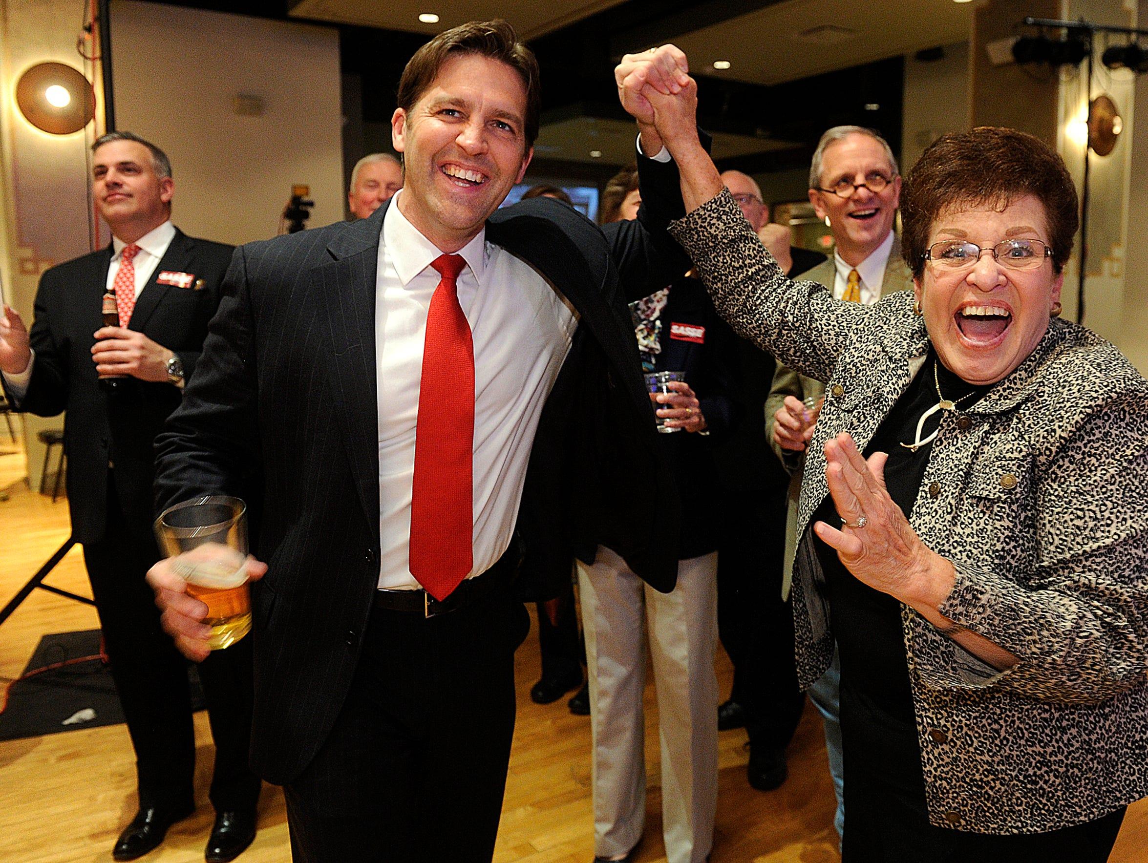 Sen.-elect Ben Sasse celebrates during his election