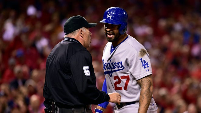 Matt Kemp argues after striking out in the ninth inning.