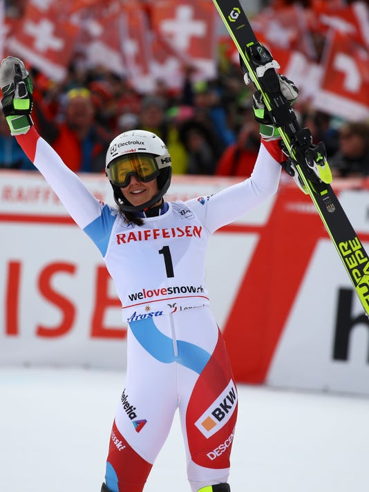 FILE - In this Jan. 28, 2018 file photo, Switzerland's Wendy Holdener celebrates at the finish line after the second run of an alpine ski, women's World Cup slalom, in Lenzerheide, Switzerland, Sunday, Jan. 28, 2018. Holdener might just be the biggest threat to past gold medalist Mikaela Shiffrin's pursuit of multiple gold medals in the technical events of slalom and giant slalom. Since failing to finish either of those races at the Sochi Olympics at age 20, Holdener has established herself as a top competitor, taking home a gold in the combined event and a silver in the slalom (behind Shiffrin) at last year's world championships. (AP Photo/Alessandro Trovati, File)