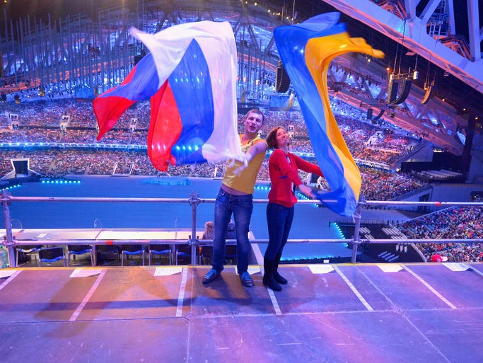 SOCHI, RUSSIA - MARCH 07: Two spectators posing with Russian and Ukranian flags during the Opening Ceremony of the Sochi 2014 Paralympic Winter Games at Fisht Olympic Stadium on March 7, 2014 in Sochi, Russia.  (Photo by Dennis Grombkowski/Getty Images)