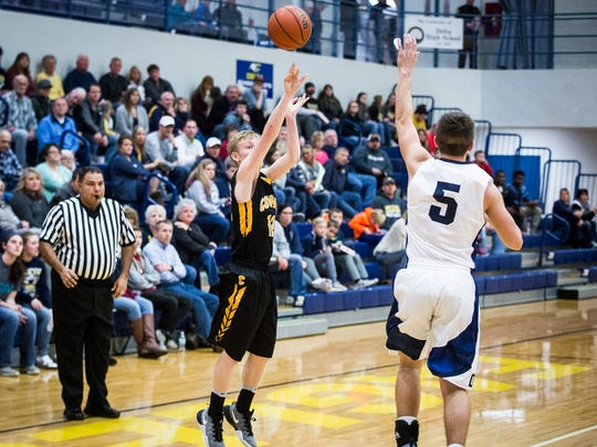 Cowan's Declan Gill shoots against Delta during the Delaware County semifinals at Delta High School Jan. 14, 2017.