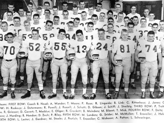 Pete Rose is No. 55 in the front row of this 1958 football team photo.