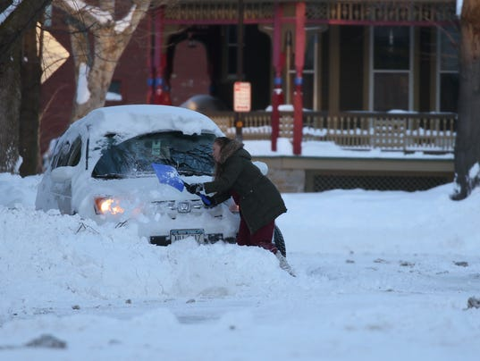 shoveling out vehicle