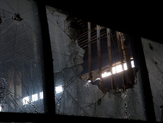 Shattered glass and exposed beams are seen Thursday