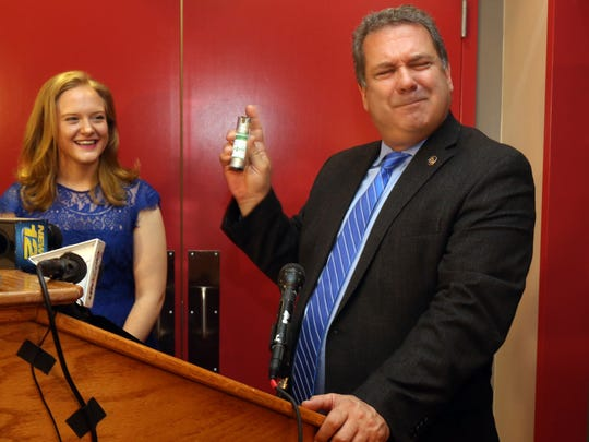 Yonkers Mayor Michael Spano holds a spray canister of medical marijuana during a ceremony to mark the opening of Etain LLC medical marijuana dispensary on Main Street in Yonkers March 30, 2016. Spano was making the point that the canister that he was holding did not contain marijuana. With him is Hillary Peckham, Chief Operating Officer of Etain.