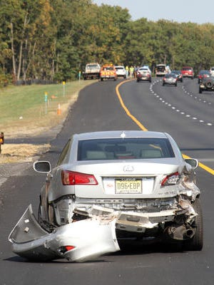A vehicle that was involved in a collision on the Garden State Parkway northbound is shown on the left shoulder south of where another vehicle ran off the roadway and into the median, leaving that driver dead Thursday.