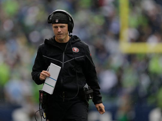 San Francisco 49ers Mike LaFleur, wide receivers coach and passing game specialist, walks on the sideline during the first half of an NFL football game against the Seattle Seahawks, Sunday, Sept. 17, 2017, in Seattle. (AP Photo/John Froschauer)
