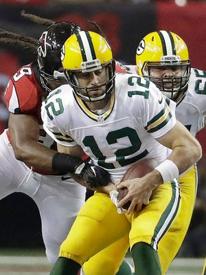 Falcons defensive end Adrian Clayborn sacks Packers quarterback Aaron Rodgers during the second half of their game on Oct. 30.