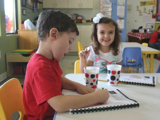 Children color a local childcare facility.