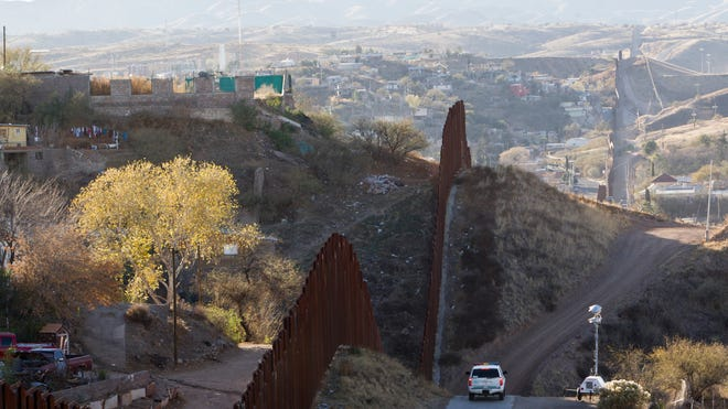 Mexican police said they found the body of an American from Tucson murdered execution-style on the main highway south of the border city.