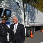 Vicksburg Police Chief Walter Armstrong and Sen. Roger Wicker, R-Miss., stand in front of a truck with two 33-foot trailers at the U.S. Capitol on Oct. 21, 2015. They oppose allowing such trucks on the highways.