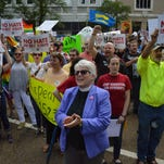 The Rev. Dr. Susan Hrostowski, an Episcopal priest of Hattiesburg, front and center, chants with activists and advocates of the Human Rights Campaign on Sunday in Jackson.