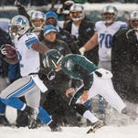 Lions kick returner Jeremy Ross evades Eagles kicker Alex Henery as he returns a kickoff for a touchdown in the fourth quarter.