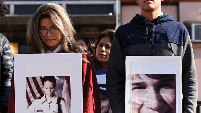 Students from Passaic High School hold pictures of the 17 victims killed at Marjory Stoneman Douglas High School in Florida during the National School Walkout in support of a student-led protest against gun violence. The walkout on Wednesday, March 14, 2018 marked the one month anniversary of the shooting.
