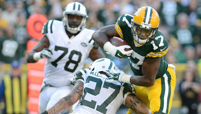 Green Bay Packers wide receiver Davante Adams (17) takes a hit from New York Jets cornerback Dee Milliner in the second quarter.