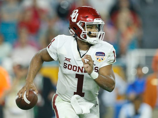 Kyler Murray scrambles against Alabama last season.
