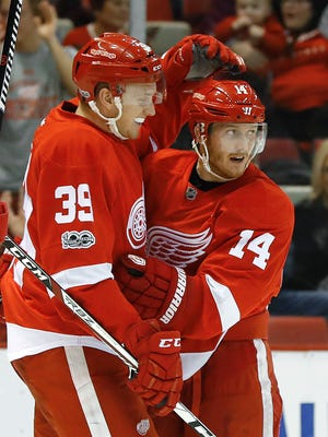 Detroit Red Wings right wing Gustav Nyquist, right, celebrates his goal against the Pittsburgh Penguins with Anthony Mantha on Jan. 14, 2017, in Detroit.