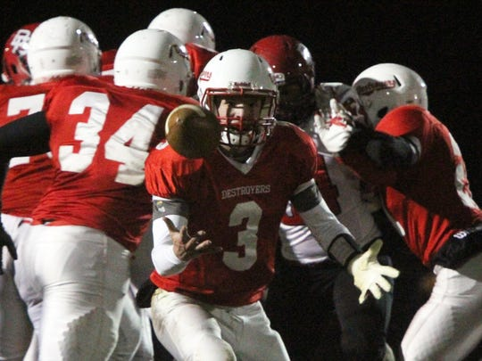 Bound Brook at Dunellen football in a Central Group I first round playoff game held at Columbia Park in Dunellen.  Dunellen's # 3- David Johnson fumbles the snap during the 1st half of play.       On Friday November 14,2014 Photo: Mark R. Sullivan/Staff Photographer
