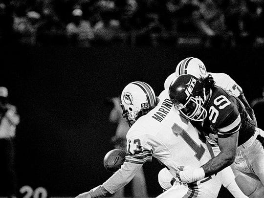 Miami Dolphins Dan Marino; left; fumbles the ball as he is sacked by Jets' star Mark Gastineau during a game Nov. 4, 1984 at Giants Stadium in East Rutherford. On Thursday, Jan. 19, 2017, Gastineau told a N.Y. radio station that he is suffering from serious health problems due to playing football.