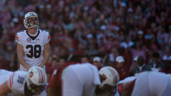 Auburn place kicker Daniel Carlson (38) look sup before kicking during the Iron Bowl in Tuscaloosa on Saturday, Nov. 26, 2016.