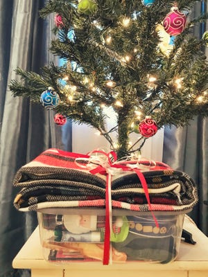 This season, donate needed items to nursing homes or assisted living centers. Be sure to call a facility first to see what they need or can accept. Shoeboxes for Seniors (pictured) is one local way to donate!