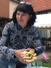 Elfriede Fackel-Kretz-Keller cleans and sorts white asparagus in her 5th-generation backyard market which is open two months each spring in Schwetzingen in Baden-Wurtemmberg, Germany.