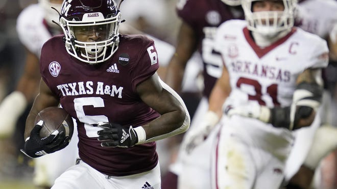 Texas A&M running back Devon Achane (6) rushes for a 30-yard touchdown run against Arkansas during the second half on Saturday, Oct. 31, 2020, in College Station, Texas.