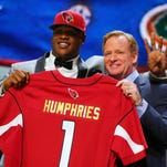 Apr 30, 2015; Chicago, IL, USA; D.J. Humphries (Florida) is greeted by NFL commissioner Roger Goodell after being selected as the number twenty-four overall pick to the Arizona Cardinals in the first round of the 2015 NFL Draft at the Auditorium Theatre of Roosevelt University.