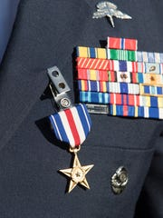 Staff Sgt. Christopher Lewis wears his Silver Star for Gallantry in Action on October 20, 2016 during a ceremony at Hurlburt Field in Florida on Friday, January 19, 2018.