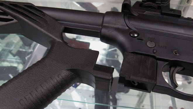 This bump stock for a .22-caliber rifle helps it fire at a rapid pace.