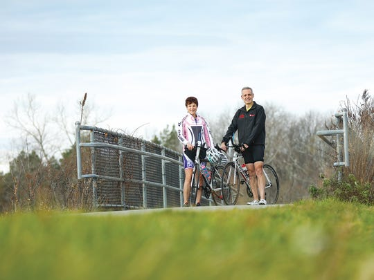 Kim and Steve Levitsky on the Erie Canal, where they spend much time exercising.