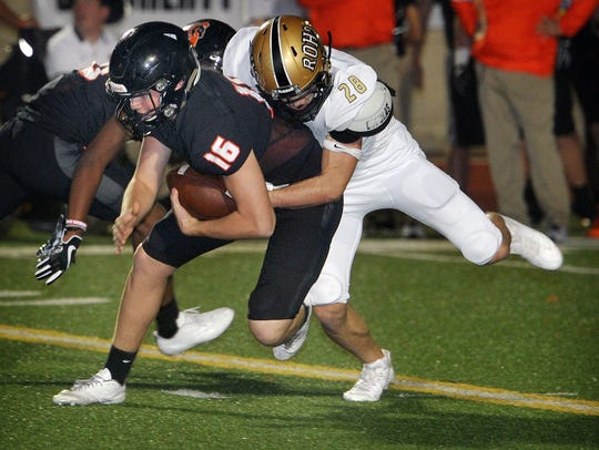 Rider's Daniel Fox makes a tackle in last season's matchup with Aledo. The Raiders believe they can play better defense against Aledo on Friday.