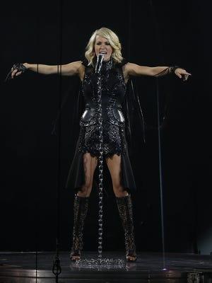 Country artist Carrie Underwood performs to a sold-out crowd of 9,404 Thursday night at the Resch Center in Ashwaubenon.