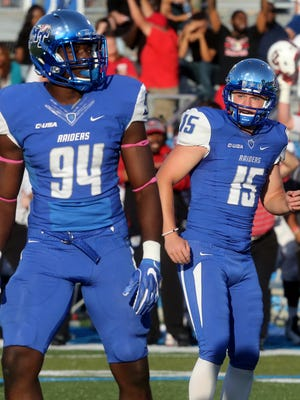 MTSU's kicker Canon Rooker (15) looks back to the bench after missing the extra point in the double overtime against WKU on Saturday, Oct. 15, 2016. MTSU's Tyshun Render (94) looks up toward the scoreboard.