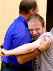 The MTSU Men's basketball coach Kermit Davis gets a