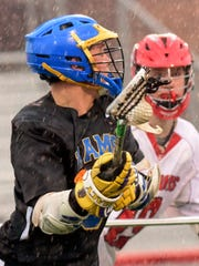 Kennard-Dale's Seth Ash handles the ball with Susquehannock's Alex Bongardt defending during lacrosse action at Tuesday, April 3, 2018.