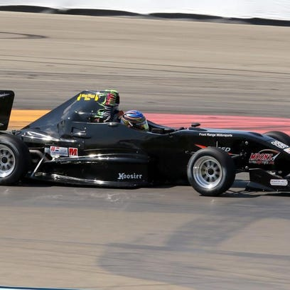 J.R. Osborne tunes up his Firman Formula 1000 car Friday during the SCCA Majors Tour event at Watkins Glen International.